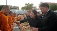 The newly-appointed Bangkok governor Pol General Aswin Kwanmuang attends an alms offering to monks at City Hall