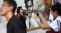 A mural bringing together nine portraits depicting the late monarch