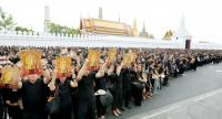 Thais wearing black in mourning for late HM King Bhumibol Adulyadej, with many also holding the King