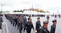 Policemen stationed at the Grand Palace are posted for duty yesterday, as officers from every corner of the Kingdom have been deployed to provide security for the thousands of loyal subjects gathering to pay their last respects to His Majesty the