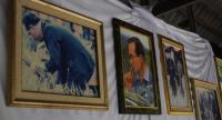Photos of His Majesty the King taken during his many rural visits, displayed on the wall at the Mab-Ueang Agri-Nature Centre.
