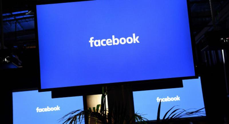 [File photo] A Facebook logo is pictured on a screen ahead of a press conference to announce the launch of it's latest product