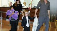 A file picture dated July 28, 2013 shows US actors Angelina Jolie, second left, and Brad Pitt, right arriving with the children Pax Thien, left, Shiloh (hidden) and Knox Jolie-Patt at Tokyo International Airport at Haneda in Tokyo, Japan.