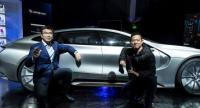 Ding Lei, left, co-founder and global vice chairman of LeEco SEE Plan, and YT Jia, right, founder, chairman, and CEO of LeEco pose with the company's LeSEE Pro electric self-driving concept car.