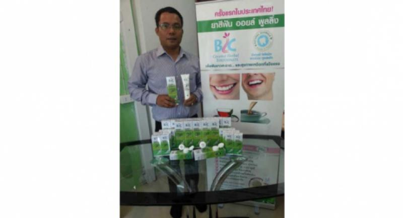 Boonlert Han-iad, managing director of BLC Cosmetic, poses with his BLC brand toothpaste, which is made from cold-pressed coconut oil and is the first of its kind in Thailand.