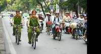 Ha Noi policemen patrolling by bicycle. it is the time to seek solutions by encouraging the public to move from motorcycles back to riding bicycles again.