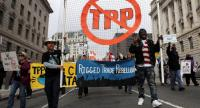 Activists shout slogans as they march during an anti-Trump and anti-TPP protest November 14, 2016 in Washington, DC. /AFP