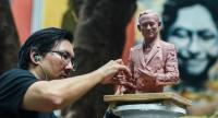 Natee Kevalakul forms plasticine into a 40centimetretall bust to be rendered in bronze. Nation/Chalinee Thirasupa