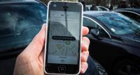 (FILES) This file photo taken on February 9, 2016 in Paris shows a smartphone displaying the app for ride service Uber with a box reading
