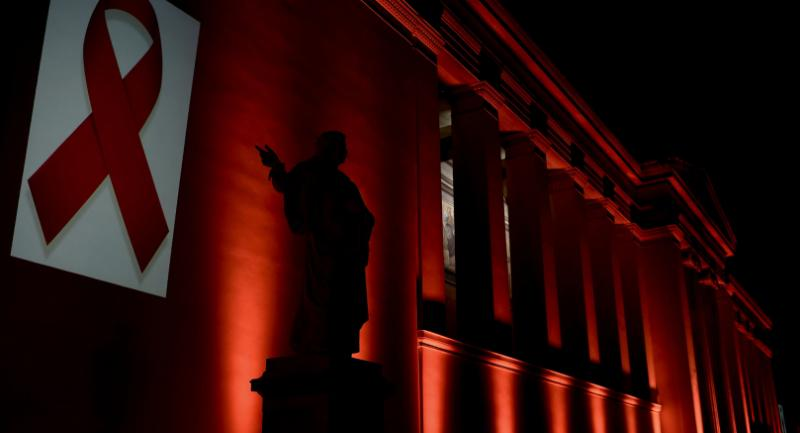 The National and Kapodistrian University of Athens is illuminated with a red light by the Hellenic Center for Disease Control