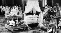 HM King Bhumibol Adulyadej and HM Queen Sirikit, preside over a blessing ritual for their son, then known as Prince Maha Vajiralongkorn, at the Ambhorn Sathan Villa in 1952.