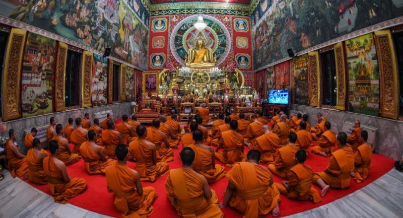 Buddhist monks at Wat Samien Naree in Bangkok