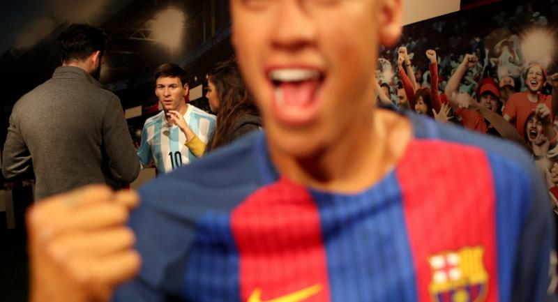 Visitors observing wax figure of Barcelona players Lionel Messi (back) and Neymar (front) at Madame Tussauds wax museum in Istanbul, Turkey, 28 November 2016./ EPA