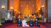 Children of HM the late King Bhumibol Adulyadej pose in front of the Royal Urn inside the Dusit Maha Prasat Throne Hall in the Grand Palace on Saturday.