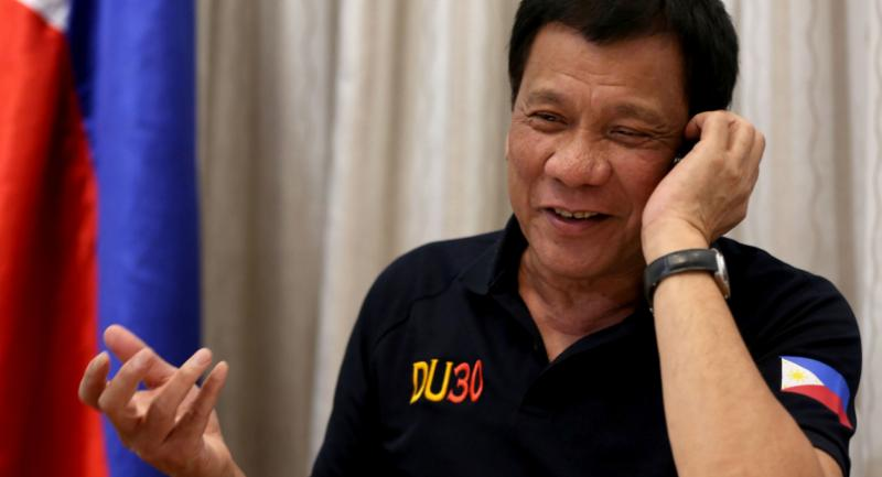 This handout photo taken by the Presidential Photographers' Division on December 2, 2016 and released December 3, 2016 shows Philippines' President Rodrigo Duterte gesturing as he talks to US President-elect Donald Trump on the phone. / AFP PHOTO