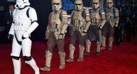 Stormtrooper characters march down the red carpet at the premiere of Walt Disney Pictures and Lucasfilm's