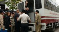Nineteen red-shirt leaders from the United Front for Democracy against Dictatorship board a Bangkok Remand Prison van after being indicted for violating the junta