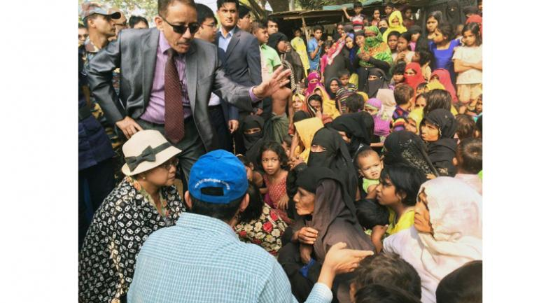 Foreign Minister Retno LP Marsudi (left, seated) talks to Rohingya Muslims at the Kutupalong refugee camp in Ukhiya, Cox