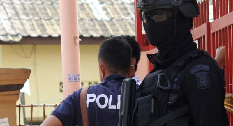 Anti-terror police at a house in Bekasi, West Java, where a bomb was discovered on 11 December 2016. Photograph: Erlangga Mahameru/AFP/Getty Images
