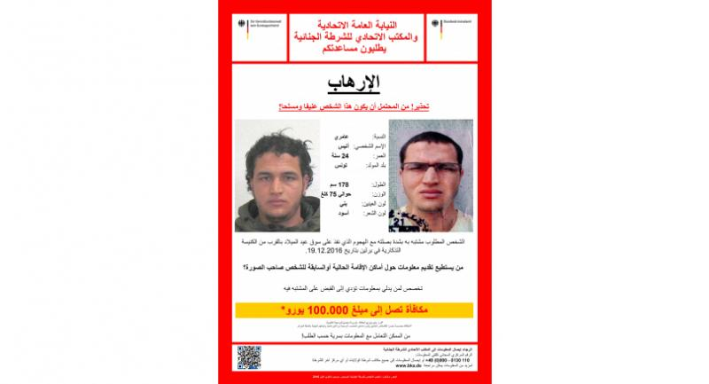 This handout picture released by the German Federal Police Office (BKA) on December 22, 2016 shows an arrest warrant in Arabic for a Tunisian man identified as Anis Amri, suspected of being involved in the Berlin Christmas market attack.  / AFP PHOTO