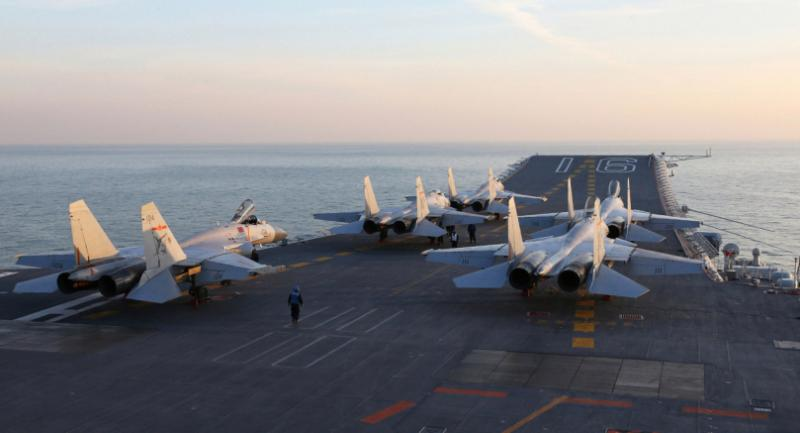 (FILES) This file photo taken on an undisclosed date in December 2016 shows Chinese J-15 fighter jets on the deck of the Liaoning aircraft carrier during military drills in the Bohai Sea, off China's northeast coast. / AFP PHOTO