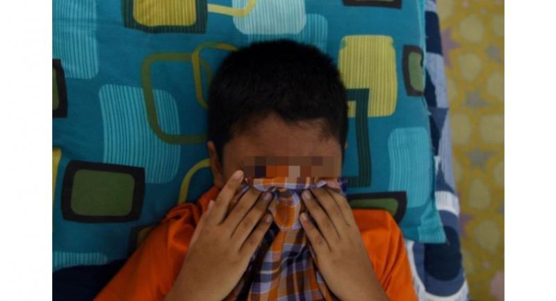 A file picture of a boy undergoing a traditional circumcision ceremony. - AFP