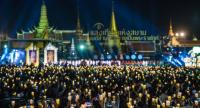 Tens of thousands of people join a candle-lit ceremony in honour of all Thai monarchs as they counted down to the New Year on Saturday night.