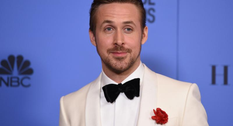 Ryan Gosling poses with his award for best actor in a musical or comedy for his role in