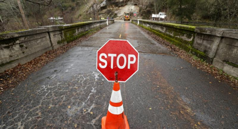 A stop sign blocks off the road as workers remove boulders, rocks and mud after a mudslide on the scenic Silverado Trail along Napa Valley in St. Helena, California, USA, 09 January 2017. / EPA