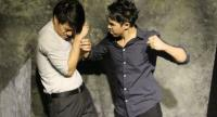 Fists fly after Satha discovers that Wichit had an affair with his wife Nam. Photo/Monkey Army Theatre