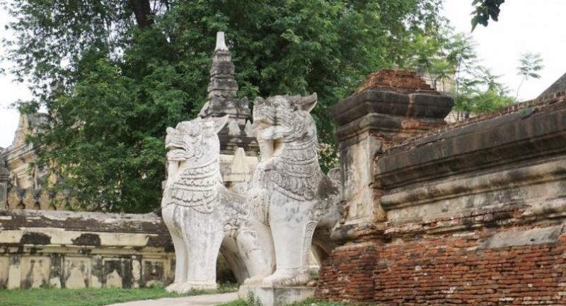 Statues of lions guard the entrance of Maha Aung Mye Bon Zan Monastery at Inwa in Myanmar. The Nation/Phoowadon Duangmee