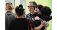 Finding comfort: Family members of victims of the catamaran that sank on its way to Pulau Mengalum console each other. - Bernama