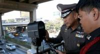 Pol Maj-General Jirapat Phumjit, the city deputy chief who oversees traffic regulations, inspects the use of