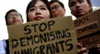 Malaysian activists hold placards during a protest against US President Donald Trump's immigration order, outside the US Embassy in Kuala Lumpur on February 3, 2017. / AFP PHOTO