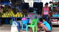 The pregnant Myanmar migrant worker (the woman on the pink) works in a market in Phuket. Photo Pratch Rujivanarom