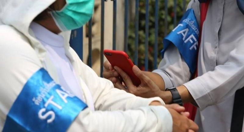 Reporters check their smartphone after the Internet signal has gone Friday.