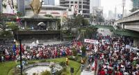 Protesters under the group BAYAN march toward the EDSA Shrine (Our Lady of EDSA) for a demonstration to mark the 31st anniversary of the EDSA People Power Revolution in Quezon City, east of Manila, Philippines February 25, 2017.