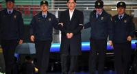 File photo: Lee Jae-Yong (C), vice chairman of Samsung Electronics, arrives for questioning at the office of a special prosecutor investigating a corruption scandal in Seoul on February 22.//AFP
