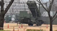 A PAC-3 surface-to-air missile launcher unit (C), used to engage incoming ballistic missile threats, is seen in position at the Defence Ministry in Tokyo on March 6, 2017/AFP