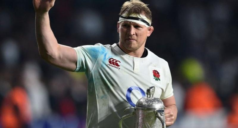 England's hooker and captain Dylan Hartley holds the Calcutta Cup trophy as leaves the pitch atfter winning the Six Nations international rugby union match between England and Scotland at Twickenham stadium/AFP
