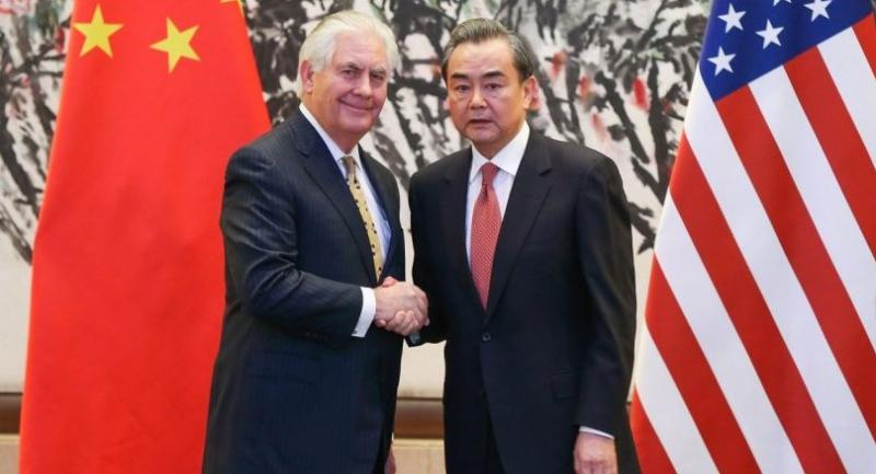 China's Foreign Minister Wang Yi (R) shakes hands with U.S. Secretary of State Rex Tillerson after a joint press conference at the Diaoyutai State Guesthouse in Beijing on March 18, 2017/AFP