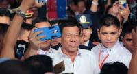 Filipino President Rodrigo Duterte greeted by members of the Filipino community at ta hotel in Naypyitaw, Myanmar on March 19. Duterte is on a four-day state visit to Myanmar and Thailand from March 20 to 22.