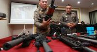 File photo: Police chief Pol Gen Chakthip Chaijinda inspects seized weapons.