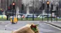 A floral tribute to the victims of yesterday's terror attack is left at the security cordon near Westminster Abbey in central London on March 23.