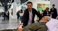 Chinese artist Shen Shaomin places his phone in the hands of a replica of Fidel Castro at Art Basel in Hong Kong. Photo/AFP