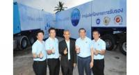 Somchai Bulsook, second right, chairman of the board of directors of Sermsuk Plc, together with President Lester Teck Chuan Tan, second left, and Uaychai Innak, centre, the Governor of Surat Thani, join the opening of Crystal
