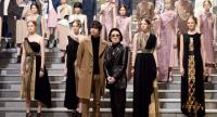 Japanese designer Yu Amatsu, centre left, and Hanae Mori, centre right, pose with their models at Tokyo Fashion Week./AFP Photo