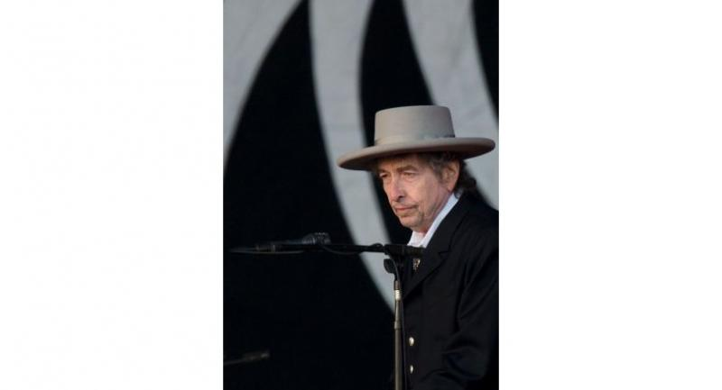 (FILES) This file photo taken on June 30, 2012 shows US musician Bob Dylan performing during the second day of the Hop Farm music festival in Paddock Wood, Kent.  / AFP PHOTO