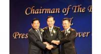 The photo shows Tanada, left, Ninnart Chaitirapinyo, chairman of TMT, centre, and Sugata, right.