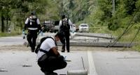 Police inspect the scene of an explosion in Pattani